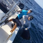 Grandson Michael & Captain George with a Sailfish
