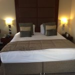 The comfortable kingsize bed and opposite the TV. Office desk with swivel chair. The pleasant tr