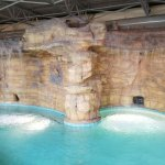 Indoor pool with cave alcoves and waterfalls.