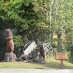 Carved wooden bears and antiques outside of the restaurant and gift store