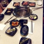 A selection of dishes with the hot brazier in the centre of the table.