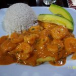 grilled corvina with shrimp and Peruvian red sauce, white rice and avocado