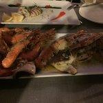 Restaurant très agréable service parfait le mix de poisson un délice un cadre sublime je recomma