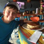 My son with his 4 stack of pancakes and my bacon