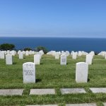 View of headstones to open ocean