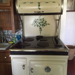 Vintage looking but totally modern electric stove in the kitchenette of the Cherry Tree Suite