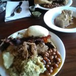 my plate (#dontjudge)stuffing, baked beans,roll, bacon, mashed potatoes, pork, bread pudding to
