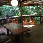 The back porch showing Rob and some of his artwork used as stools
