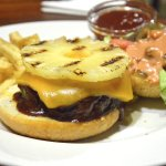 dry beef burger drenched in sauce and a thick piece of pineapple which confused everything