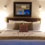 Rose petals on the bed of the Penthouse Suite