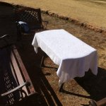 Dirty towel left to dry on picnic table