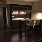 Tastefully appointed room with wet bar and high top table