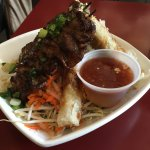 Grilled pork and crispy roll vermicelli bowl.
