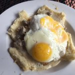 Fried Chicken and Bicuits with sausage gravy and fried eggs