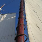 Sail attached to main mast with wooden mast hoops