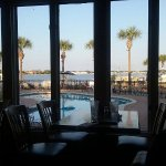Our beautiful view of the pool & bay as we ate our meal at sunset.