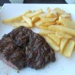 Rib-eye steak and chips.