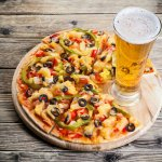 28771024-pizza-on-the-table-with-a-glass-of-beer--Stock-Photo_large.jpg