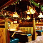 Wood booths with antler lamps overhead