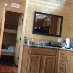 The kitchen area and dining table on left. One of two TV's is right there. The Bunk bed room
