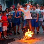 local children take part in the annual feast of St John where they jump through the flames at Lo