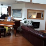 Guest area where you can play a baby grand.