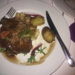 Steak with mixed vegetables in rich wine sauce
