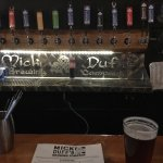 The Mick Duff craft beer handles behind the bar...
