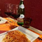 House wine, still water and pasta All'Amatriciana