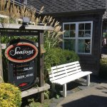 Directional sign to Seasons Cafe, right on a walking path off of Cannon Beach's main street.
