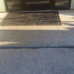 Small step in the wheelchair ramp to the door.