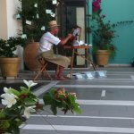 a painter at the entrance of the hotel