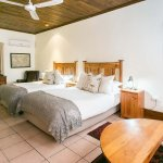 Family 6 sleeper room at Matoppo Inn with 2 x double beds and sleeper couch