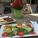 Delicious shrimp salad and a glass of house rose