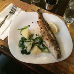The grilled local fish with boiled potatoes and spinach