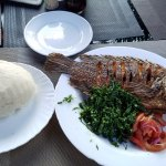 Fried Tilapia with ugali and seasonal vegetables