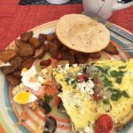 Omelet with veggies, potatoes and arepas (and a bite of Eggs Benedict)