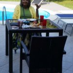 Enjoying breakfast by the pool, nice bright, cool day