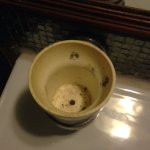 Cup next to bathroom sink. UGH