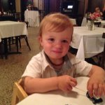 Our grandson at our table.