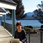 My wife working at the balcony of Radfords with her back against the backdrop of the lake