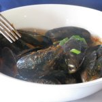 delicious mussels in a well seasoned tomato sauce