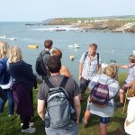 Roger addresses the group whilst looking across Bude bay.