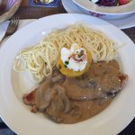 Escalope veal with mushroom sauce, the bacon and egg Rosti, fondue and Movenpick icecream