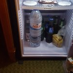 refrigerator...big enough to store a large bottle of water; mini bar items were reasonably price