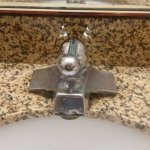 Installed nice looking granite but kept old faucets!