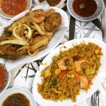 Fried mixed seafood platter and seafood paella