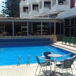 Poolside with plenty of seating....sunbeds....the restaurant(part alfresco)to the back and the b