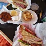 Pastrami and turkey sandwiches, potato latke and potato knish.