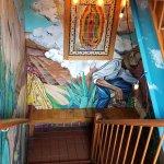 Walk down stairs to access restaurant. Nice murals, art.